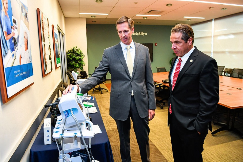 Welch Allyn President Alton Shader shows New York Gov. Andrew Cuomo a display of the company's medical device products at the company's headquarters in Skaneateles on Wednesday, Sept. 28. from Syracuse.com
